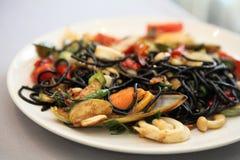 Ink squid spaghetti white sauce with ham Stock Image