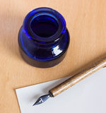 Ink-stand and pen. Ink-pot and old pen for handwriting with ink and nib Royalty Free Stock Image