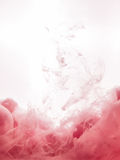 Ink swirl in water isolated on white background. The paint in the water. Soft dissemination a droplets of pink ink in Royalty Free Stock Photo