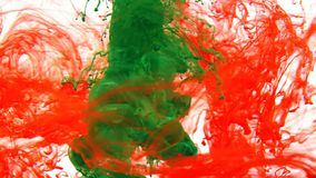 Ink swirling in water, Color drop in water photographed in motion.  royalty free stock photo