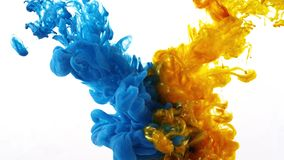 Ink swirling in water, Color drop in water photographed in motion stock photography
