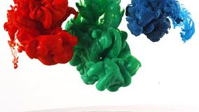 Ink swirling in water, Color drop in water photographed in motion. N royalty free stock image