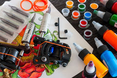 Ink tattoo machines. And accessories stock images