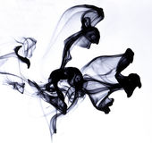 Ink in water. On white background royalty free stock photography