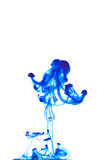Ink in water. Ink dancer in water isolated on a white background stock image