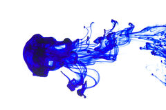 Ink in water. Abstract pattern background with blue ink in water royalty free stock image