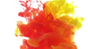 Colour ink reacting in water creating abstract cloud formations. red yellow ink on white background. Ink in water. Colour ink reacting in water creating abstract stock video footage