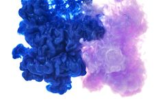 Ink in water. Splash paint mixing. Multicolored liquid dye. Abst stock image