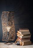 Ink well with lamp and old book Stock Images