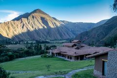 The Inkaterra Hotel in Peru. View of the Inkaterra Hotel with the Andes Mountains in the View of the Inkaterra Hotel with the Andes Mountains in the Background stock photography