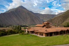 The Inkaterra Hotel in Peru. View of the Inkaterra Hotel with the Andes Mountains in the View of the Inkaterra Hotel with the Andes Mountains in the Background stock images