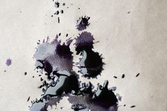 Inkblot On Paper. Inkblot closeup on old paper background Stock Photography