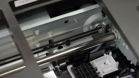 Inkjet printer head in action. Close up view
