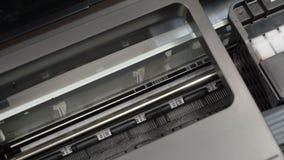 Inkjet printer starts and stops printing stock video