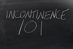 Inkontinens 101 på en svart tavla Royaltyfri Bild