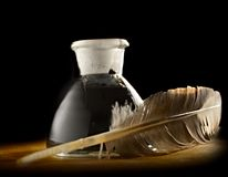 Inkpot and a feather Stock Image