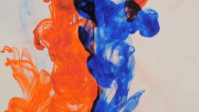Inks in water. Red and blue. Slow motion stock footage