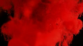 Inkt in water Het kleurenrood schittert verf die in water reageren creërend abstracte wolkenvormingen Kan als overgangen worden g stock videobeelden