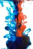 Inkt in water, kleurenabstractie, kleurenexplosie stock foto