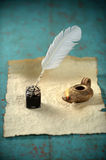 Inkwell and Ancient Lamp Royalty Free Stock Photography