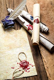 Inkwell and ancient scrolls royalty free stock images
