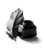Inkwell and quill. Feather quill and inkwell over white background Stock Photography