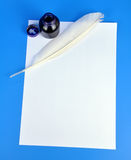 Inkwell and quill. On white paper Stock Image