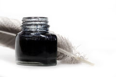 Inkwell and quill. Feather quill and inkwell over white background Royalty Free Stock Photography