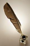 Inkwell y pluma Foto de archivo
