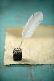 Inkwell y pluma Foto de archivo libre de regalías