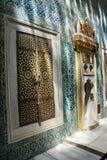 Inlaid doors and mosaic tiles Royalty Free Stock Photos