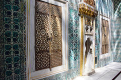 Inlaid doors and mosaic tiles Royalty Free Stock Images
