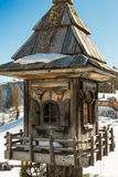 Inlaid wooden bird house near mountain's chalet Royalty Free Stock Images