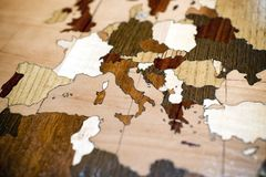 Inlaid wooden map showing European countries. Inlaid wooden map showing the European countries in a variety of colored woods in a full frame oblique angle royalty free stock image