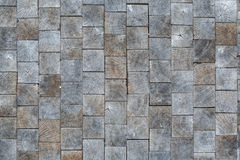 Inlaid wooden tiles as the background, conceptual in nature Stock Image