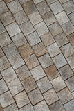 Inlaid wooden tiles as the background, conceptual in nature Stock Photos