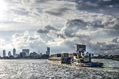 Inland barge approaching Rotterdam stock photography