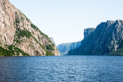 Inland fjord between rugged steep cliffs Royalty Free Stock Photos