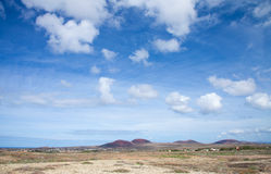 Inland Fuerteventura. View towards Lajares from the Malpais de la Arena, late autumn and little green appearing after rains Stock Photos