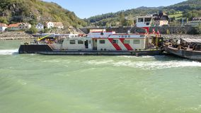 Inland shipping vessel, the YBBS on the Danube River pushing a loaded barge, Wachau Valley, Lower Austria stock image