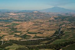 Inland Sicily and the road leading between the hills to the volcano Etna Royalty Free Stock Photography