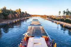 Inland vessel drives a canal Stock Photo