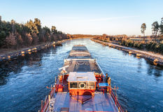 Inland vessel drives a canal Stock Photography