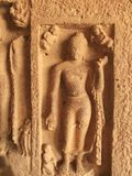 Inlay sculptures in Buddhist cave Royalty Free Stock Photography