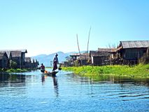 Inle lake in the afternoon. Inle lake life style in the afternoon with bamboo houses and local people earn leaving by fishing and make floating vegetables farm Royalty Free Stock Photography