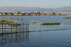 Inle Lake, Burma (Myanmar). Mountains in the background. The beautiful Inle Lake is a popular tourist destination in Myanmar Royalty Free Stock Images