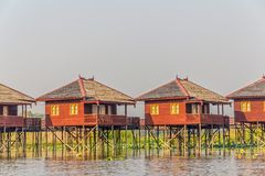 Inle lake hotels. INLE LAKE, MYANMAR - FEBRUARY 28, 2013: Replica of the traditional floating village engineered as a hotel with bungalows royalty free stock photo