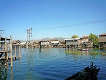 Inle lake Myanmar with blue sky background. Inle lake early in the morning local people use a boat for transportation instead of a car. Most of a houses build Stock Photo