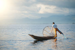 INLE LAKE, MYANMAR - DEC 12' 2010: Intha Fisherman in Inle stock photography
