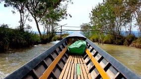 Trip on fast canoe, Inle Lake, Myanmar. INLE LAKE, MYANMAR - FEBRUARY 18, 2018: Canoe trip along the banks of Inn Thein Indein village, famous tourist landmark stock footage